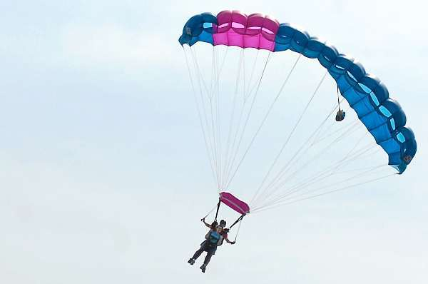 Bangor Daily News reporter Khela Kupiec and instructor Matt Riendeau of Central Maine Skydiving approach their landing target at Pittsfield Municipal Airport while taking a 10,100 foot tandem parachute plunge Friday morning, June 18, 2010. (photo: courtesy of Steve Straub)