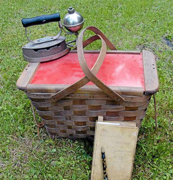 Among the discovered treasures at the 30-mile yard sale this weekend were an antique iron, an old picnic basket, an orginal Fannie Farmer's cookbook and a fountain pen.  JULIA BAYLY PHOTO