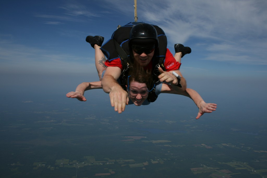Bangor Daily News reporter Khela Kupiec (bottom) and instructor Matt Riendeau of Central Maine Skydiving take a 10,100 foot tandem plunge back Pittsfield Municipal Airport shortly after taking off from there on June 18.