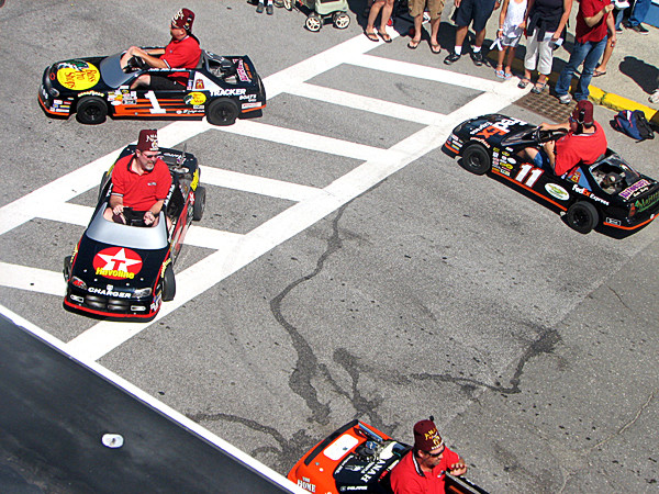 Shriners zip around in go-carts made to look like NASCAR cars on Cottage Street during a parade in downtown Bar Harbor on Saturday, July 3. The town held many of its annual Independence Day festivities a day early this year, but the local annual Fourth of July fireworks are scheduled to be held Sunday evening.  BANGOR DAILY NEWS PHOTO BY BILL TROTTER