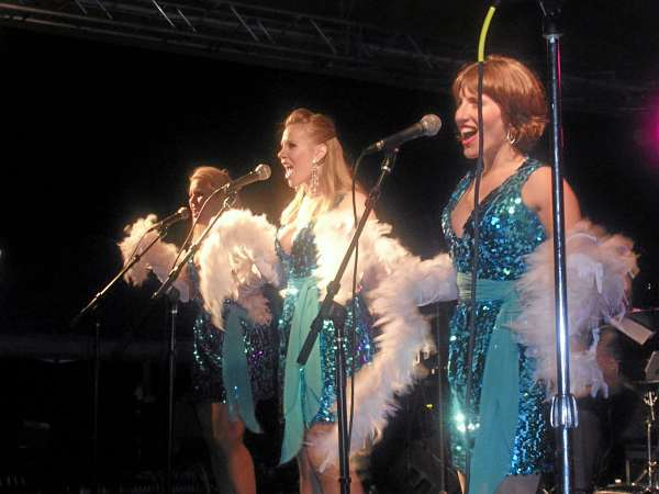 Three ladies sang songs, such as &quotThe Shoop Shoop Song&quot and ABBA's &quotDancing Queen&quot after the firework display in Camden Harbor on July 3. The free concert was put on by Bay Chamber Concerts, which celebrates its 50th birthday this year. (Bangor Daily News/Heather Steeves)