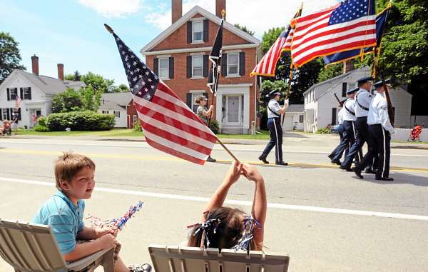 Cousisn Mason Scott, 7, (left) and Kaelyn Grace Boyington,4, both of Brewer watch the Fourth of July parade in Brewer Sunday.   (Bangor Daily News/Gabor Degre)