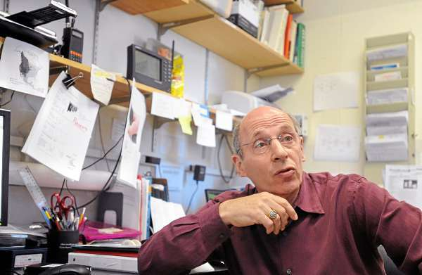 Irv Kornfield in his office at the University of Maine in Orono.  Kornfield is the associate director of the School of Marine Sciences but also teaches fornecics classes where students can utilize the Molecular Forencics Lab.  They don't only work on mock cases set up for learning but also process samples for the Maine Warden Service. (Bangor Daily News/Gabor Degre)