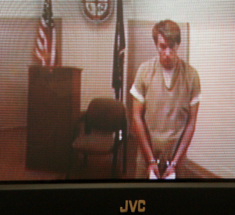 Thayne Ormsby is seen during a video arraignment in district court in Rochester, N.H., from the Strafford County jail in Dover, N.H., on Tuesday, July 6, 2010. Ormsby is charged in the stabbing deaths of three people in Maine. He is being held without bail. (AP Photo/Jim Cole)