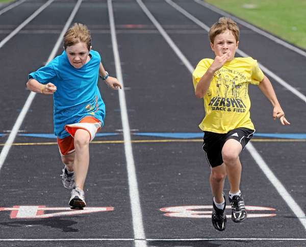 Paul Lussier, 10, of South Portland (left) and Jake Stevens, 9, of Preque Isle cross the finish line during the 9-10 year-old boys 50 meter runing competition during the Hershey State track meet at Cameron Stadium in Bangor Tuesday.  Stevens won the event with the time of 8.55 seconds and Lussier finished third. (Bangor Daily News/Gabor Degre)