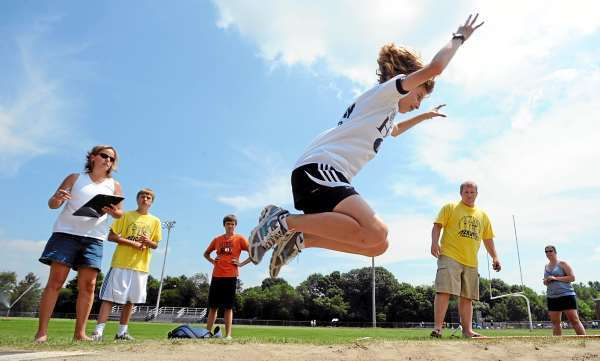 Hannah Ferris competes in the 13-14 year-old girls standing long jump competition during the Hershey State track meet at Cameron Stadium in Bangor Tuesday.   (Bangor Daily News/Gabor Degre)