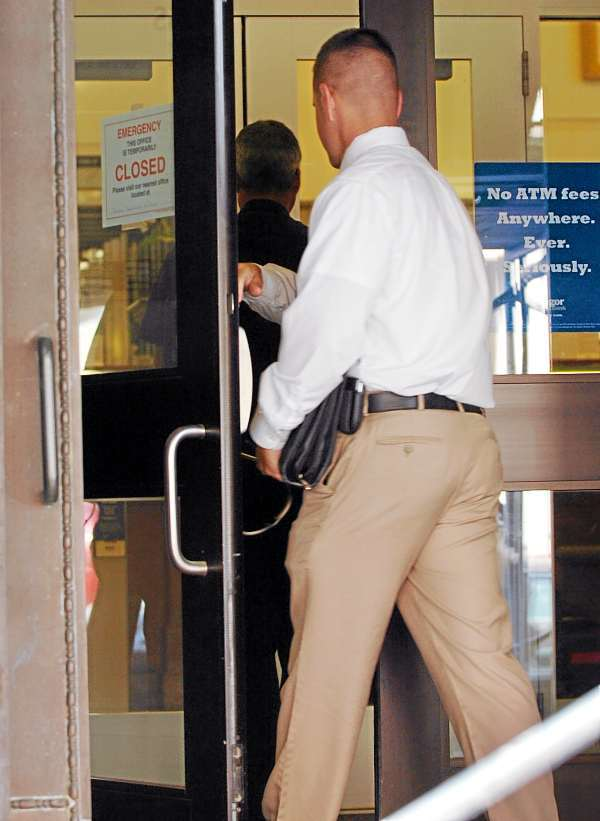 Bangor Police Department members enter Bangor Savings Bank at 3 State Street on Tuesday, July 6, 2010 where a robbery occured shortly after 9:30 a.m. A suspect, who has now been taken into custody, took an undisclosed amount of cash and left the bank in a taxi cab. (Bangor Daily News/Bridget Brown)