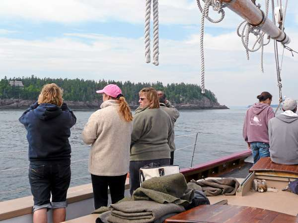 Passengers aboard the Sylvina W. Beal, a schooner out of Eastport, watch for whales Wednesday during a scenic cruise. Local whale watching companies are hoping good weather and the early return of whales will make up for the rough season they had last year. It rained all of June and into July although the number of whales spotted in August and September was record-breaking. (Bangor Daily News/Sharon Kiley Mack)