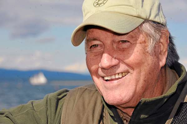 Jim Fowler talked with fellow Maine Environmental Research Institute supporters during a boat tour on Eggamoggin Reach and Blue Hill Bay Thursday, July 1, 2010. Fowler, a wildlife conservation advocate and a host with the long-running TV show &quotMutual of Omaha's WIld Kingdom&quot, was in coastal Maine for several days and hosted Maine Environmental Research Institute's  20th anniversary celebration in Blue Hill Friday night.   BANGOR DAILY NEWS PHOTO BY JOHN CLARKE RUSS