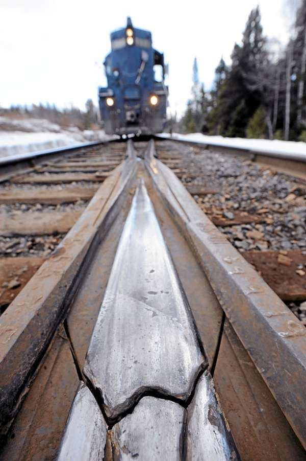 This fractured &quotfrog&quot on Montreal, Maine & Atlantic Railway could be seen in front of one of the railway's trains as it made a stop to pick up more freight in Masardis recently. A &quotfrog&quot is a railway switch that enables trains to move from one track to another at a railway junction.  (BANGOR DAILY NEWS PHOTO BY JOHN CLARKE RUSS)  CAPTION  This fractured &quotfrog&quot on Montreal, Maine and Atlantic railway could be seen in front of one of the railway's trains as it made a stop to pick up more freight in Masardis Thursday, March 18, 2010. A &quotfrog&quot is an industry slang term for a railway switch which enables trains to move from one track to another at a railway junction. Safety concerns and poor maintenance along sections of the MM&A railway in northern Maine sometimes limit the speed of their freight trains to 10 to 15 mph.  State officials are seeking a $25 million bond to repair rail in Aroostook, Penobscot and Androscoggin counties. Without such aid railways like MM&A might have to abandon their 241 miles of track which remain crucial to Maine industries. (Bangor Daily News/John Clarke Russ)