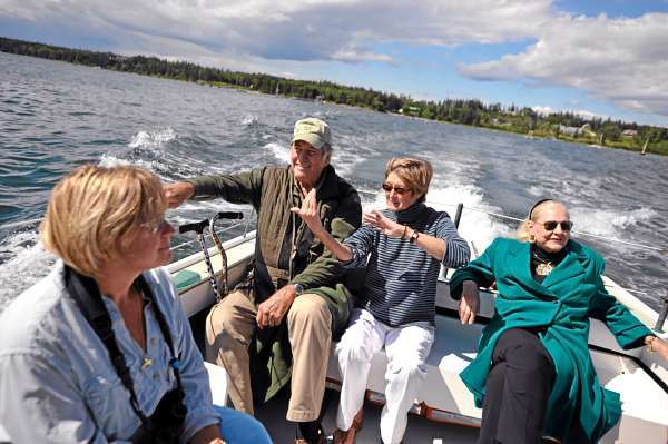 During their boat tour in the Blue Hill Bay area Thursday, July 1,  MERI director  and  marine toxicologist  Dr. Susan Shaw, center, discussed ecological issues with Jim Fowler (second from left), his wife Betsey Fowler  (cq) , far right, Leslie Clapp of Bar Harbor, far left,  and others aboard MERI's research vessel. Fowler, a wildlife conservation advocate and host of the long-running TV show &quotMutual of Omaha's WIld Kingdom&quot, was in coastal Maine for several days and hosted Maine Environmental Research Institute's  20th anniversary celebration in Blue Hill Friday night.  BANGOR DAILY NEWS PHOTO BY JOHN CLARKE RUSS