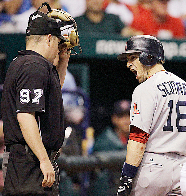 Boston Red Sox's Marco Scutaro (16) screams at home plate umpire Todd Tichenor, left, after being called out on strikes on a pitch from Tampa Bay Rays' David Price during the seventh inning of a baseball game Wednesday, July 7, 2010, in St. Petersburg, Fla. Catching for Tampa Bay is Kelly Shoppach. (AP Photo/Chris O'Meara)