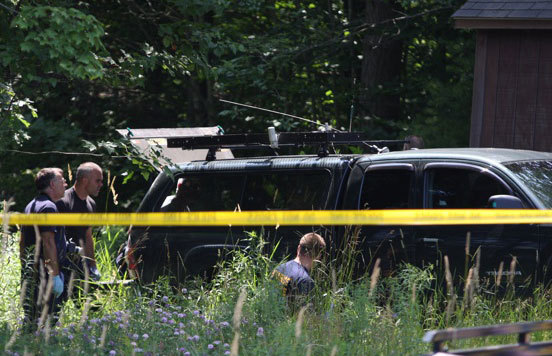 Maine State Police officers search a toyota pickup truck registered to a Grindstone man who was shot and killed by police on Thursday in Augusta.