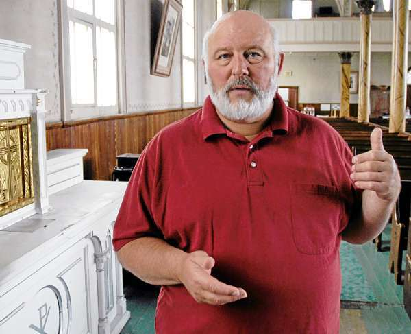 Don Cyr, director of the Musee culturel du Mont-Carmel is a tireless and enthusiastic supporter of all things Acadian and cultural. He has been working to restore the former church for close to three decades. &quotThis is my life's work,&quot he said. (photo by Julia Bayly).
