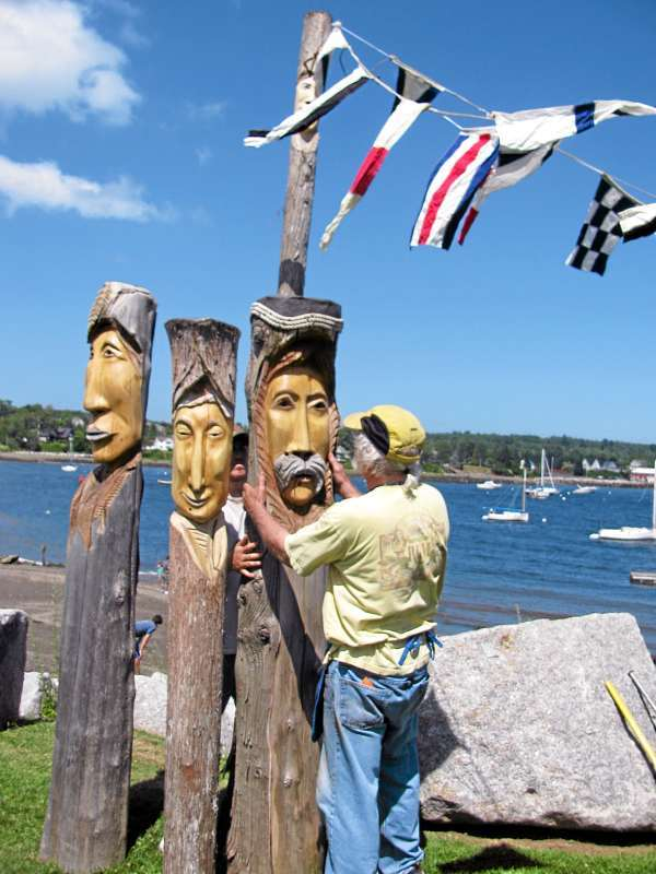 Sculptor Ron Cowan sets up his wooden Muses on Friday, July 9, at the waterfront in Belfast, Maine. He said that he would display about 40 of the unusual wood carvings for this weekend's Arts in the Park festival, which will be held from 10 a.m. - 4 p.m. Saturday, July 11 and Sunday, July 12 at Heritage Park. &quotThis is a wonderful show,&quot Cowan said of the 15th annual festival. BANGOR DAILY NEWS PHOTO BY ABIGAIL CURTIS