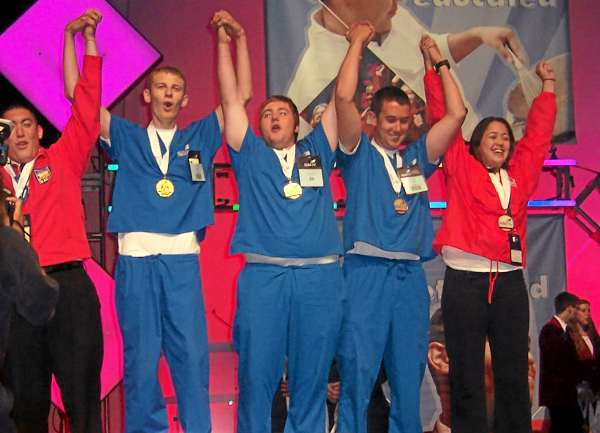 Ten students from Bangor's United Technologies Center (UTC) represented the State of Maine in a variety of events at the annual National Competition for SkillsUSA. This picture shows two gold medal winners from Maine in First Aid/CPR as they received their medals: Postsecondary student Tyler Nadeau, 1st one on the left in blue scrubs, who was a UTC graduate, is now attending EMCC. This is Tyler's second gold medal in the national event; Secondary student Devin Lyshon, middle one in blue scrubs, just graduated from UTC.  Both students attended the Public Safety program at UTC. (Photo courtesy of United Technologies Center)