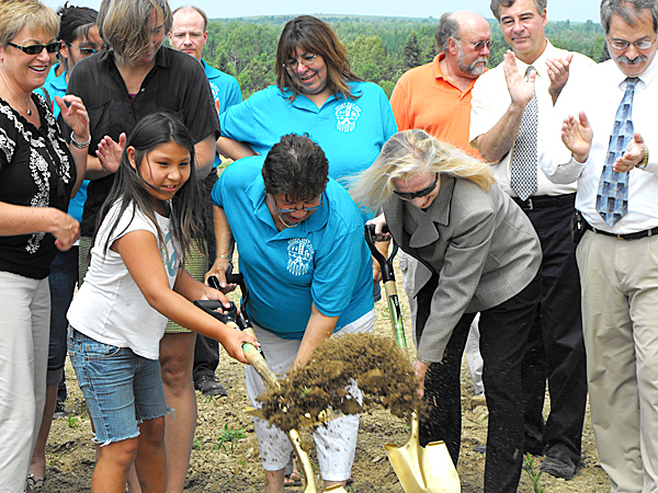 CARIBOU, FROM LEFT: Mishun Morey, 8, a member of the Aroostook Band of Micmacs, joins tribal Chief Victoria Higgins and Virginia Manuel, U.S. Department of Agriculture rural development state director, in breaking ground on the tribe's new indoor farmers market and fish hatchery on Friday, July 9. The facility, which is located on U.S. Route 1 in Caribou, will feature greenhouse and cold storage space and will be open to all farmers who want to sell their produce. (BANGOR DAILY NEWS PHOTO/JEN LYNDS)