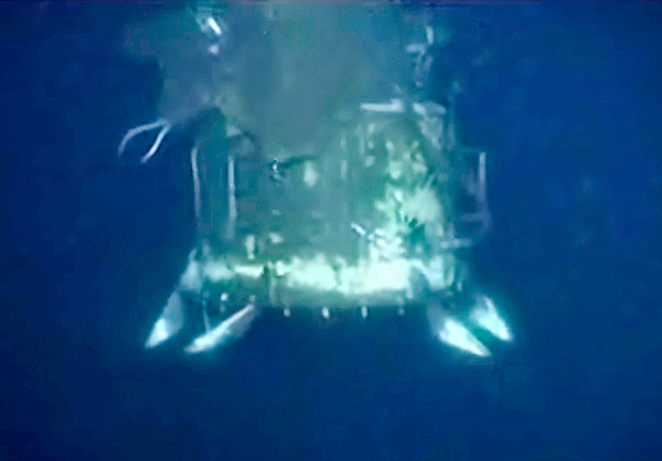 In this image taken from video provided by BP PLC, the containment cap that had previously been covering the well head at the Deepwater Horizon oil spill site in the Gulf of Mexico, is lifted above the gushing leak on Saturday, July 10, 2010. Officials say a tighter dome will be installed to funnel more oil to collection ships on the surface a mile above.