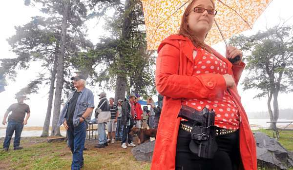 Elizabeth Jutras, 23, of Bar Harbor was among the about 25 people who attended the Maine Open Carry Association picnic in Acadia National Park on Thopson Island Saturday.   The group was holding the event to mark the last day people can openly carry firearms in Maine's only National Park.  The new law however does not prohibit people with concealed weapons permits to carry a gun in the park. (Bangor Daily News/Gabor Degre)