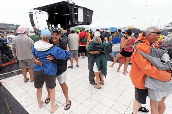 A rain soaked crowd dances to singer/songwriter/guitarist Michael Burke  on Sunday, July 11, 2010 during the North Atlantic Blues Festival in Rockland.  (Bangor Daily News/Kevin Bennett)
