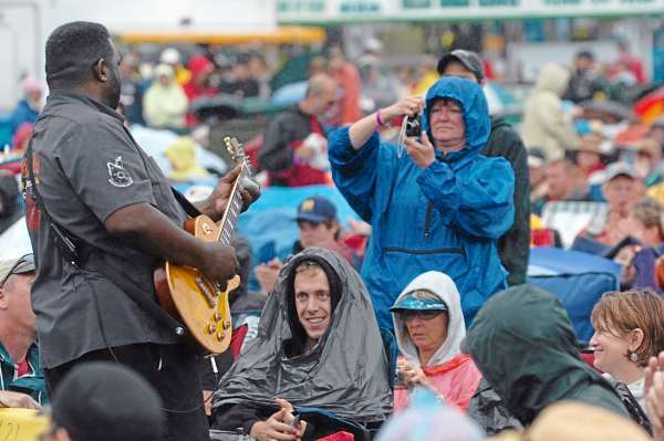 Blues guitarist Michael Burkson wanders into the crowd Sunday, July 11, 2010 during the North Atlantic Blues Festival in Rockland to interact with audience members as he plays his rock and roll infused blues for a rain soaked crowd on the Rockland waterfront.  (Bangor Daily News/Kevin Bennett)