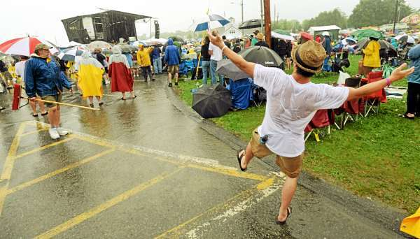 Thomas Petrettimagnani of Long Island NY dances in a driving rain to the blues sounds of Shemekia Copeland on Sunday, July 11, 2010 during the North Atlantic Blues Festival in Rockland. (Bangor Daily News/Kevin Bennett)
