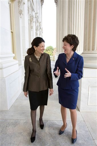FILE - In this Oct. 22, 2009, file photo Maine's Republican Senators Olympia Snowe, left, and Susan Collins walk on Capitol Hill in Washington. Now that it's been shorn of unrelated tax and spending provisions that have held it up for more than four months, the bill to extend unemployment benefits finally seems poised to pass.  (AP Photo/Harry Hamburg, File)
