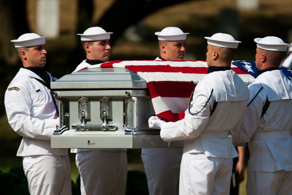 A Navy Honor Guard carries the casket of Ensign Robert Langwell, U.S. Navy, to his burial site in section 40 at Arlington National Cemetery in Arlington, Va., Monday, July 12, 2010. Langwell was one of 2  sailors missing after the USS Magpie struck mine off the coast of Chuksan-ri, South Korea, on Oct. 1, 1950.  (AP Photo/Drew Angerer)