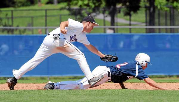 Hampden's Justin Amaroso (left) tags Bangor's Nate Lewis as he got cought between second and third base base during the third inning of the American Legion Baseball game at the Mansfield Stadium in Bangor Monday. (Bangor Daily News/Gabor Degre)