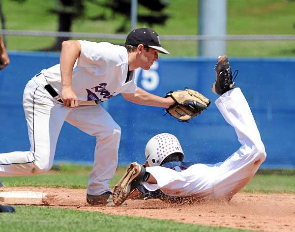 Hampden's Nolan Turner (left) tags Bangor's Cody McInnis at second base during the first inning of the American Legion Baseball game at the Mansfield Stadium in Bangor Monday. (Bangor Daily News/Gabor Degre)