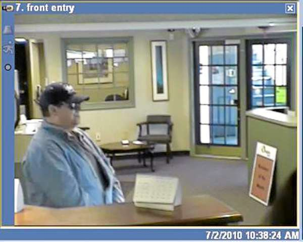 FBI-Boston has released these photos of the &quotBurly&quot Bandit, believed responsible for at least ten robberies in four states. This photo:  Merrimack, N.H., July 2, 2010. (FBI photo)