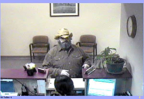 FBI-Boston has released these photos of the &quotBurly&quot Bandit, believed responsible for at least ten robberies in four states. This photo: Tewksbury, Mass., April 27, 2010. (FBI photo)