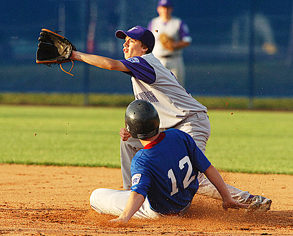 Hampden's Robert Stowe stretches to met the ball as Bangor's Nick Leach safely steals 2nd base during first inning action during the Junior League all star championship game at Mansfield Stadium in Bangor on Wednesday, July 14, 2010. (Bangor Daily News/Kevin Bennett)