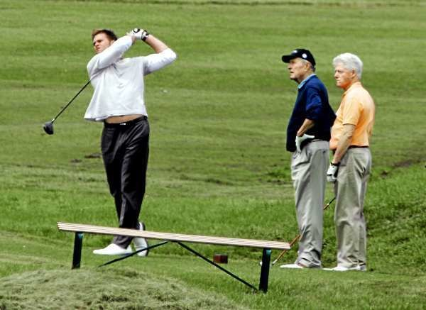A QUARTERBACK AND TWO PRESIDENTS   New England Patriots' quarterback Tom Brady (left) tees off as former Presidents Bush (center) and Bill Clinton look on during the George Bush Cape Arundel Classic a t the Cape Arundel Golf Club in Kennebunkport on Tuesday. The event raises money for Gary's House, a place for families to stay while being treated at Portland's Mercy Hospital. Clinton was visiting with Bush at his family's summer home on the Maine coast.  (AP Photo/Pat Wellenbach)