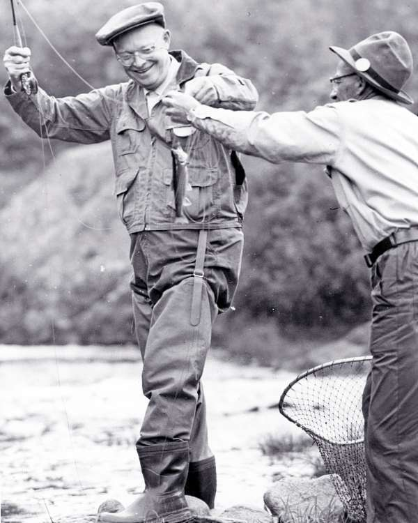 President Dwight Eisenhower beams at the first fish he caught while vacationing in Maine on June 26, 1955. He was fishing at Little Boy Falls on the Megalloway River in the Parmachenee Lake region of western Maine.  BANGOR DAILY NEWS PHOTO BY EDDIE BAKER