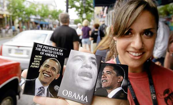 In this Tuesday, July 13, 2010 photo, Ellyn Getz, of Boston, who works in a local store in Bar Harbor, Maine, poses with President Obama magnets that are for sale in the store. The president is scheduled to visit  Mt. Desert Island this coming weekend.(AP Photo/Pat Wellenbach)