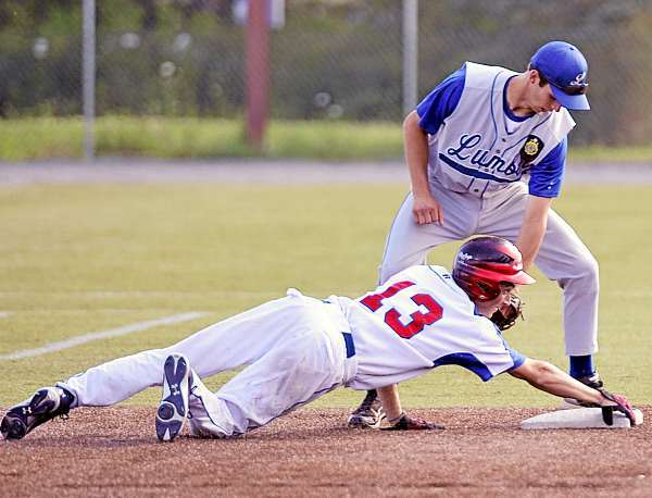Motor City's J.J. Johnson, (13), hangs onto the corner of the second base bag to avoid the tag by Lincoln's Dakota Sleeper, (7), on a steal in the third inning of their play-in game at Husson UNiversity field, Thursday, July 15, 2010. (Bangor Daily NEws/Michael C. York)