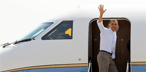 President Barack Obama waves as he boards Air Force One, Friday, July 16, 2010, at Andrews Air Force Base, Md. (AP Photo/Haraz N. Ghanbari)