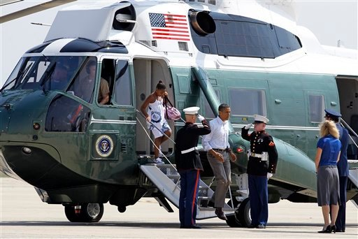 Two Marines salute as President Barack Obama and daughter Sasha step off Marine One, Friday, July 16, 2010, at Andrews Air Force Base, Md. (AP Photo/Haraz N. Ghanbari)