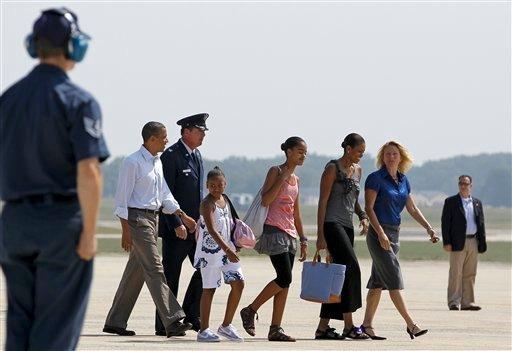 President Barack Obama, first lady Michelle Obama, daughters Sasha and Malia are accompanied by Air Force Col. Lee dePalo, vice commander of the 316th Wing, and his wife Kelly dePalo as they walk toward Air Force One, Friday, July 16, 2010, at Andrews Air Force Base, Md. (AP Photo/Haraz N. Ghanbari)