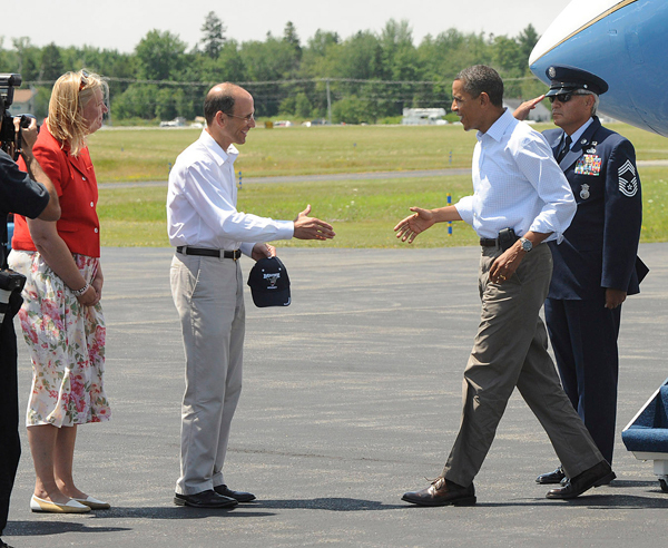 President Barack Obama (right) is greeted by Gov. John Baldacci and his wife, Karen Baldacci, shortly after arriving at the Bar Harbor Airport Friday, July 16, 2010 for a weekend vacation on Mount Desert Island. (Bangor Daily News/Gabor Degre)