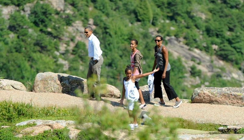 The first family walks around near the summit of Cadillac Mountain in Acadia National Park Friday afternoon. (Bangor Daily News/Gabor Degre)