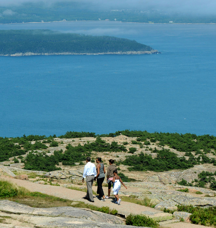 The first family walks around near the summit of Cadillac Mountain in Acadia National Park Friday afternoon, July 16, 2010. (Bangor Dailky News/Gabor Degre)