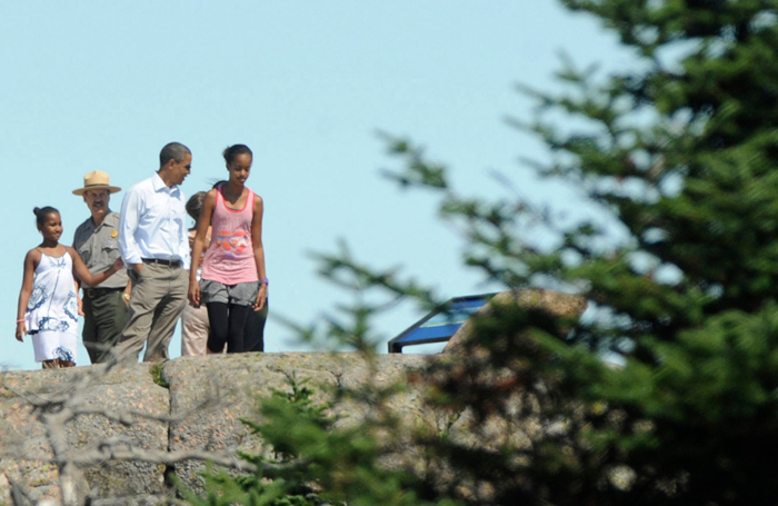 The first family walks around near the summit of Cadillac Mountain in Acadia National Park with park superintendent Sheridan Steele (second from left). (Bangor Daily News/Gabor Degre)
