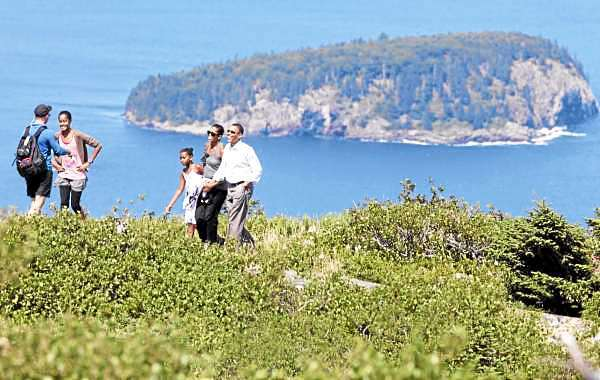 Acadia National Park Superintendent Sheridan Steele leads President Barack Obama, first lady Michelle Obama, daughters Malia and Sasha, during their visit to Cadillac Mountain in Acadia National Park, Bar Harbor, Maine, Friday, July 16, 2010. (AP Photo/Charles Dharapak)