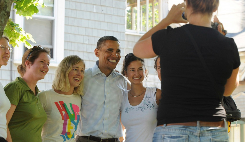 President Barack Obama poses for a picture with a group of German students after he stopped for ice cream at Mount Desert Island Ice Cream while visiting Bar Harbor Friday, July 16, 2010.  (Bangor Daily News/Gabor Degre)