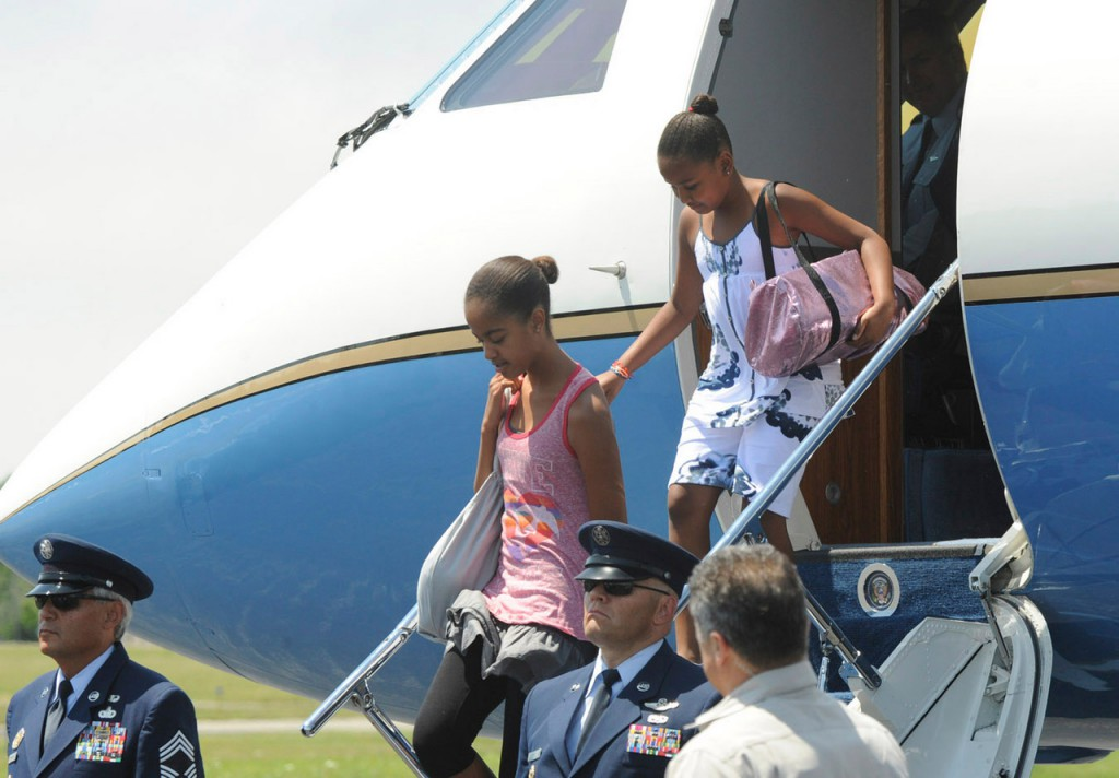 President Barack Obama daughters Sasha,9, (right) and Malia, 12,  arriving at the Bar Harbor Airport Friday. BANGOR DAILY NEWS PHOTO BY GABOR DEGRE