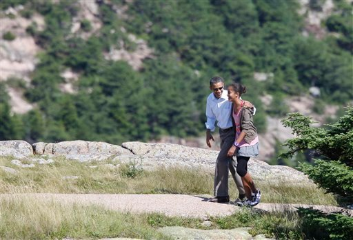 President Barack Obama walks with daughter Malia as they visit Cadillac Mountain in Acadia National Park, Bar Harbor, Maine, Friday, July 16, 2010. (AP Photo/Charles Dharapak)