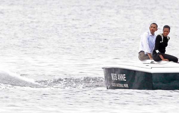 President Barack Obama and first lady Michelle Obama takes a boat tour of Frenchman Bay in Bar Harbor, Maine, Friday, July 16, 2010. (AP Photo/Charles Dharapak)