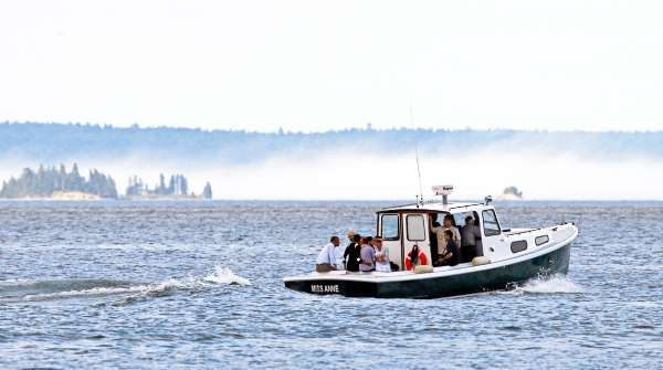 Fog is seen on Frenchman Bay in Bar Harbor, Maine, as President Barack Obama and his family take a boat tour Friday, July 16, 2010.  (AP Photo/Charles Dharapak)